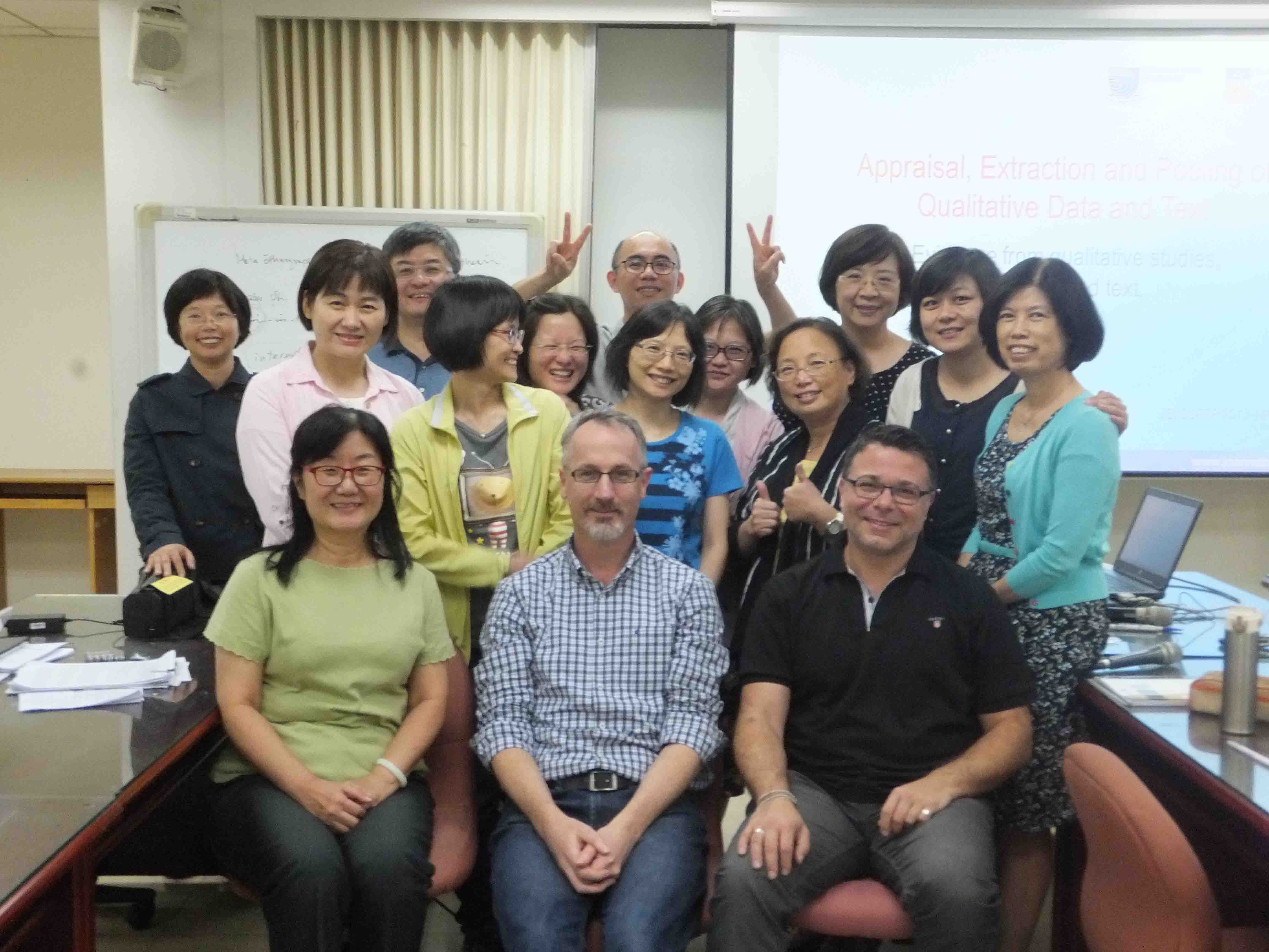 A group photo of speakers from Australia JBI headquarters with trainees.